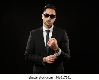 Confident businessman portrait isolated on dark background