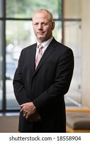 Confident businessman posing in full suit