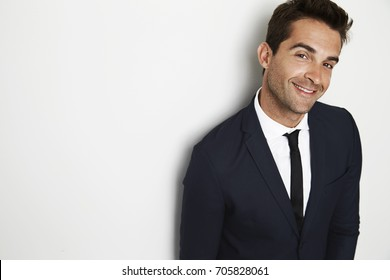 Confident businessman in smart suit looking to camera
