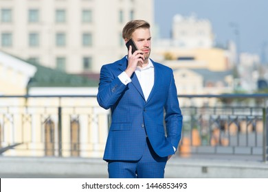 confident businessman speaking on phone. making business on move. business man with mobile phone. wireless connection. business online. Billionaire. handsome man in fashion suit. modern life.