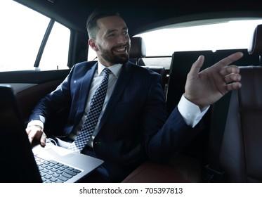 Confident businessman talking in car