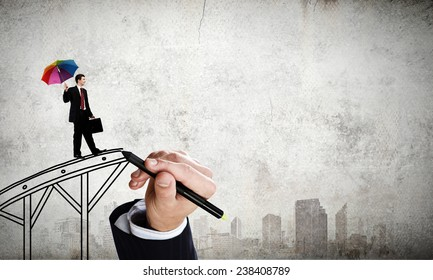 Confident businessman walking on drawn bridge over gap