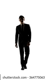 Confident businessman walking, silhouette portrait isolated