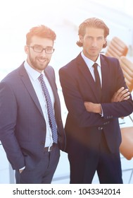 confident businessmen standing together in office