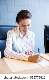Confident businesswoman in business meeting in conference room at office