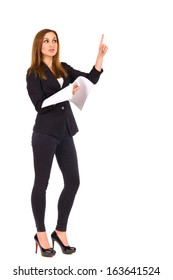 Confident businesswoman holding documents and directing. Full length studio shot isolated on white.