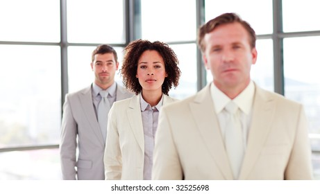 Confident businesswoman in a line with her colleagues