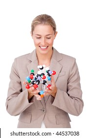 Confident businesswoman looking at a molecule isolated on a white background
