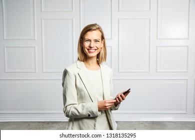 Confident businesswoman with phone, smiling