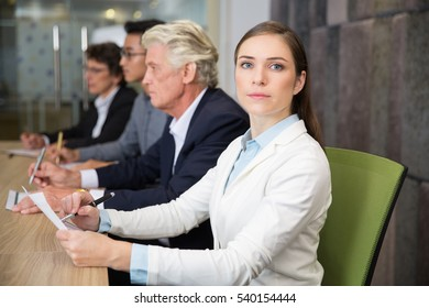 Confident businesswoman sitting at conference