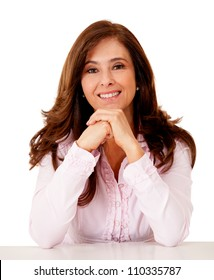 Confident businesswoman sitting on her desk - isolated over white