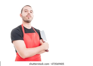Confident butcher posing with arms crossed and holding sharp knife isolated on white with text area