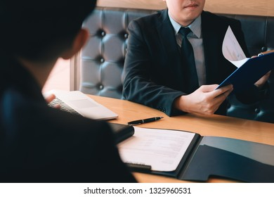 Confident caucasian manager interviews talking with a client prospective male employee.
