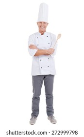 Confident chef. Full length of confident mature chef in white uniform keeping arms crossed and smiling while standing against white background