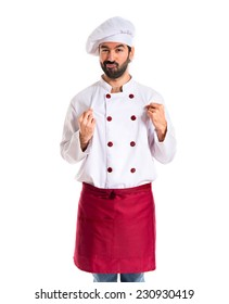 Confident chef over white background