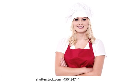 Confident chef posing to camera with crossed arms.