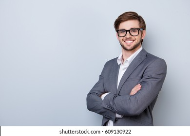 Confident cute smart business man with spectacles in formal wear.
