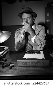 Confident detective smoking at desk in trench coat, 1950s film noir style.