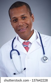 Confident doctor in uniform with stethoscope looking at camera