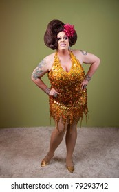 Confident drag queen with hands on hips over green background