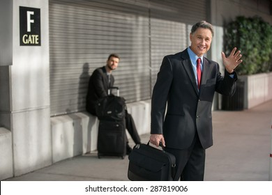 Confident elder successful man traveling at the train station
