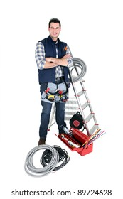 Confident electrician standing on white background