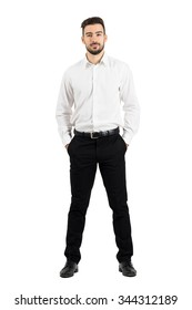 02c078152f hombre camisa · camisa blanca manga larga. Confident elegant business man  with hands in pockets looking at camera. Full body length portrait