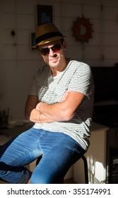 Confident entrepreneur, portrait of happy mature man working as fashion designer and dressmaker in atelier