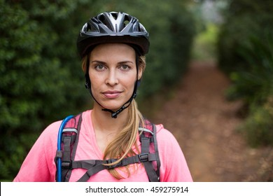Confident female athletic wearing bicycle helmet