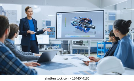 Confident Female Automotive Engineer Reports to Diverse Team of Specialists, Businesspeople and Investors Sitting at the Conference Table, She Use Interactive TV, Analyze Sustainable Energy Engine - Shutterstock ID 1844044180