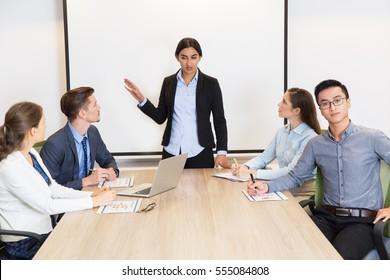 Confident female business coach having seminar