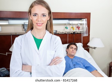 Confident female doctor with patient in hospital
