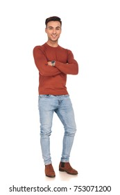 confident fit casual man smiling while standing with hands crossed on white background