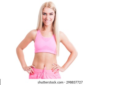Confident fitness girl isolated on white background with text area or copy space smiling to the camera