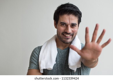 confident fitness man pointing up five finger; portrait of happy, healthy, confident, friendly fitness asian man pointing number 5 finger sign or hand gesture; asian north indian adult man model