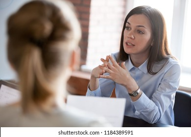 Confident focused businesswoman, teacher or mentor coach speaking to business people at negotiations, woman leader speaker applicant talking at meeting or convincing hr during job interview concept