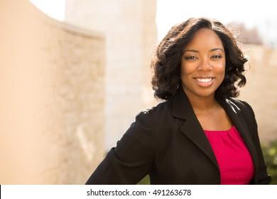 Confident friendly black business woman.