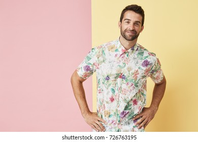Confident guy in floral shirt, smiling to camera