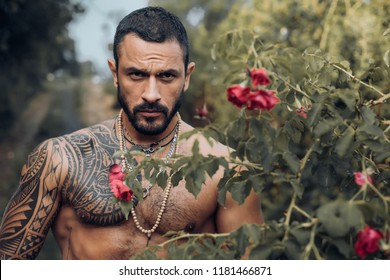 Confident and handsome Brutal man. Stylish sexy man looking away. Portrait of handsome male model. Brutal handsome man with tattooed body. Men fashion Brutal models