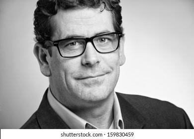 Confident handsome businessman closeup portrait black and white
