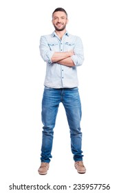 Confident handsome. Full length of handsome young man in casual wear keeping arms crossed and smiling while standing isolated on white background