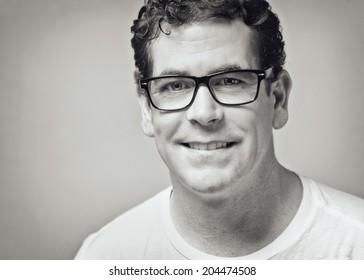Confident handsome man closeup black and white toned portrait