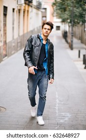Confident and handsome young man with cool style in the street
