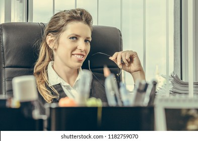 Confident happiness young woman working in her office. Beautiful Freelancer Woman working online at her home. Beauty business woman concept.
