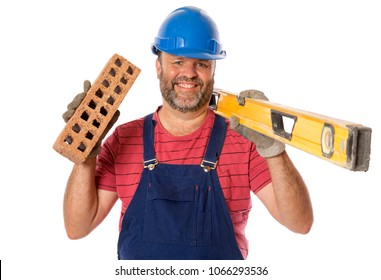 A confident and happy bricklayer posing for camera with tools of the trade