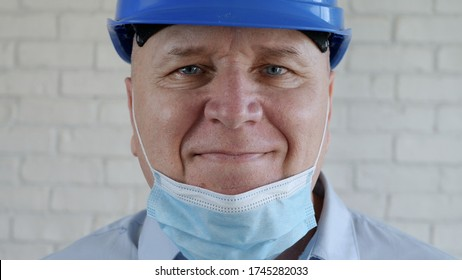 Confident Image with an Engineer Smiling and Wearing Face Protection Mask Against Viruses