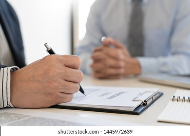 Confident insurance agent broker man holding document and present pointing showing an insurance policy contract form to client  Business Communication Connection Concept
