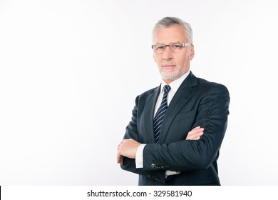 confident intelligent  business expert with gray beard and glasses crossing hands