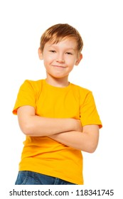 Confident kid standing in yellow t-shirt isolated on white