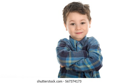 Confident little boy smiling with crossed hands